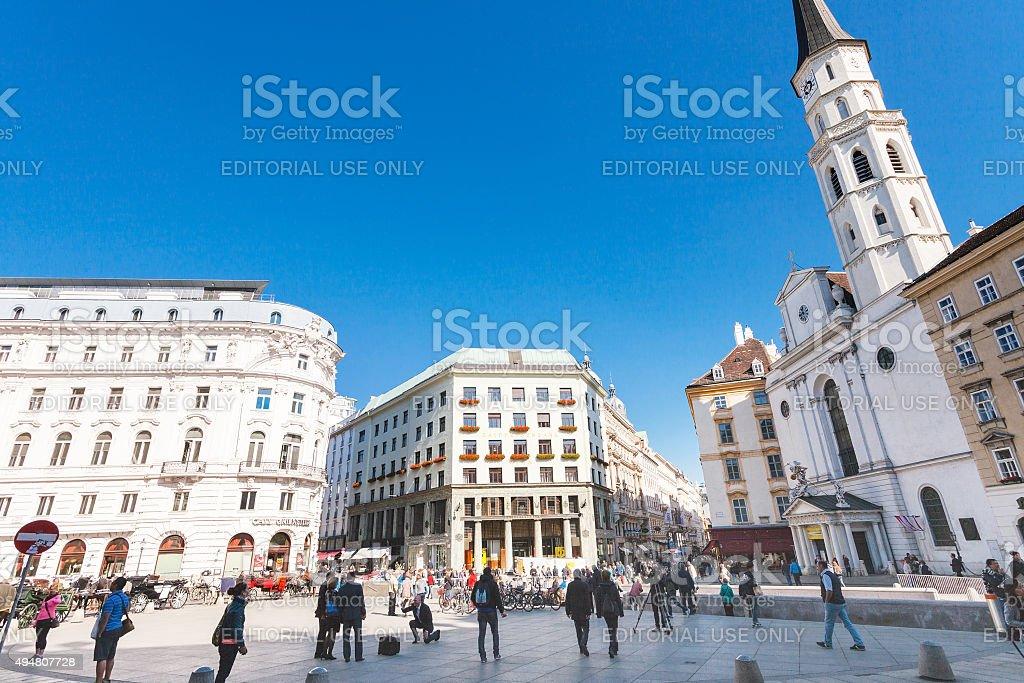Tourist on Michaelerplatz in Vienna stock photo