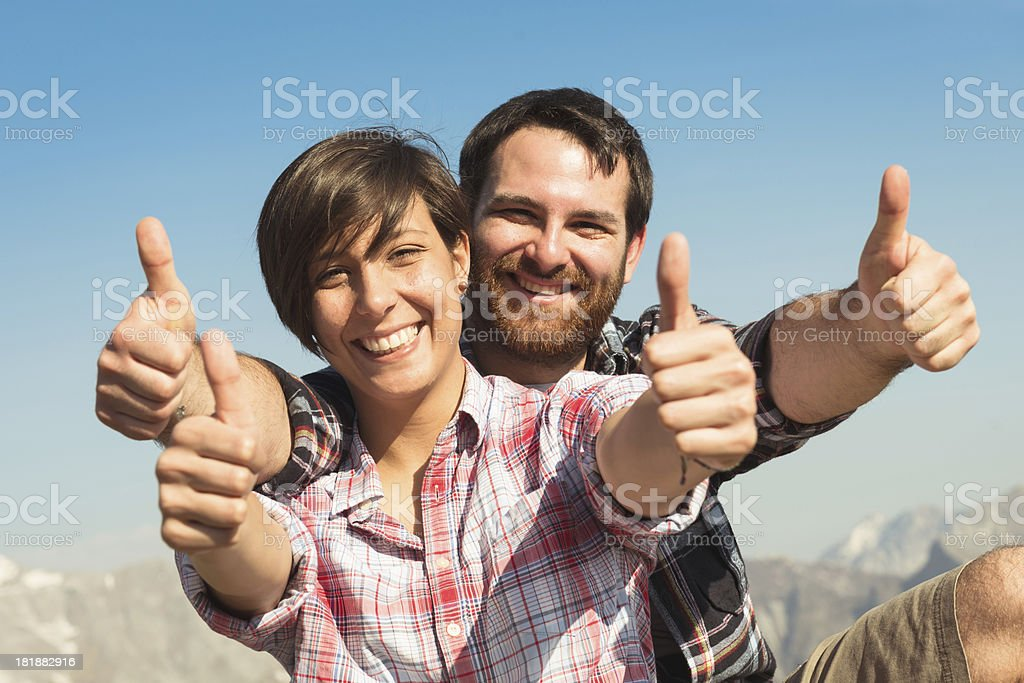 Tourist on mountain with thumbs up royalty-free stock photo