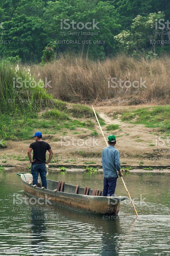 Tourist on rowboats. Chitwan-Nepal. stock photo