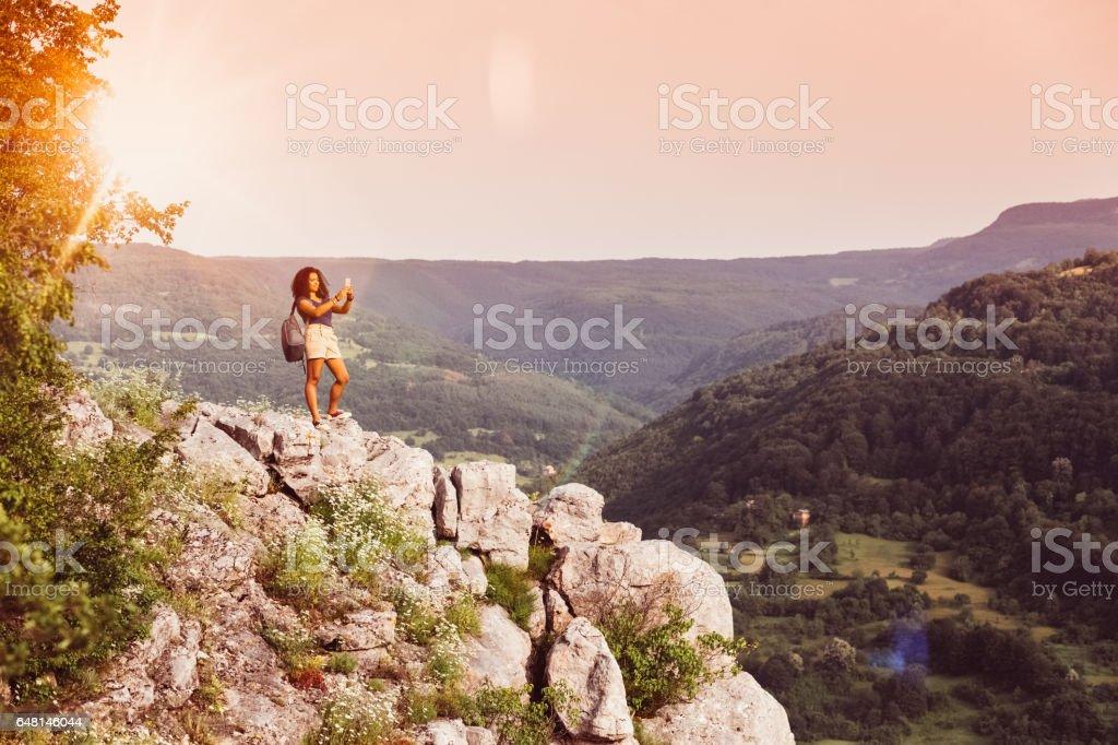 Tourist on the mountain top stock photo