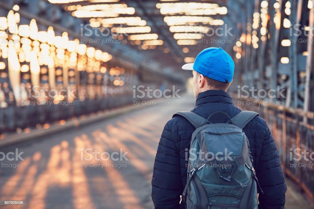 Tourist on the old iron bridge stock photo