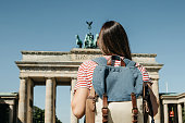 istock A tourist or a student with a backpack near the Brandenburg Gate in Berlin in Germany. 1150082789