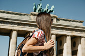 istock A tourist or a student with a backpack near the Brandenburg Gate in Berlin in Germany. 1150082793