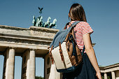istock A tourist or a student with a backpack near the Brandenburg Gate in Berlin in Germany. 1150083458