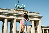 istock A tourist or a student with a backpack near the Brandenburg Gate in Berlin in Germany. 1150083887