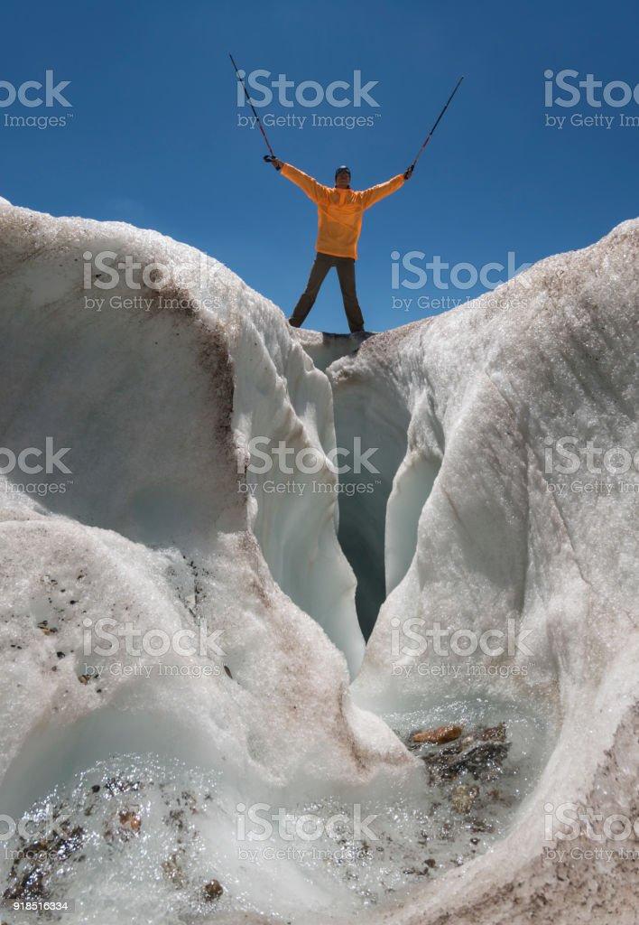 Tourist over glacier crack stock photo