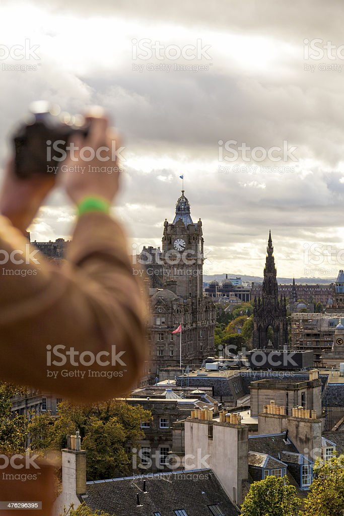 Tourist photographing Edinburgh stock photo