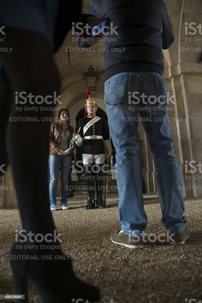 Tourist Poses for a Snapshot Portrait with London Guard stock photo