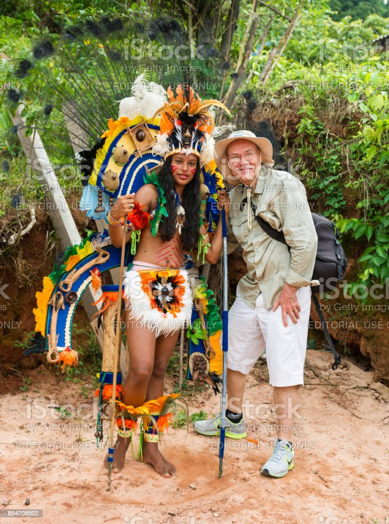 Tourist Poses for Photograph with Resident of Boca da Valeria, Brazil stock photo