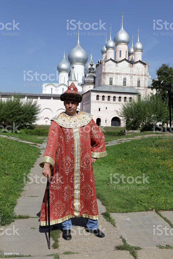 Tourist poses in historical clothes royalty-free stock photo