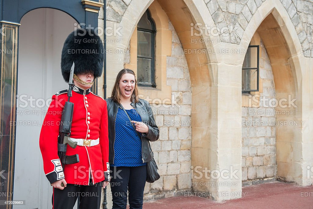 Tourist Poses with Queen's Guard at Windsor Castle stock photo