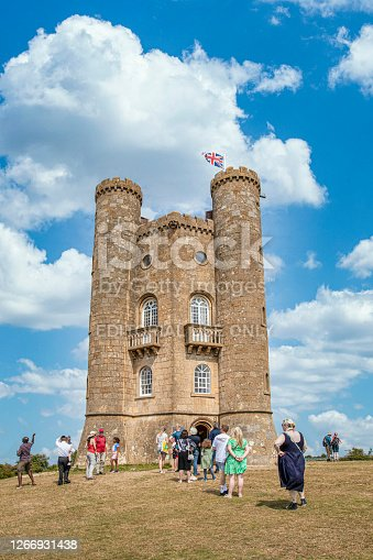 Tourist queuing up to visit the famous Broadway Tower on a lovely Summers day, sitting high in the Cotswold landscape. Broadway Tower is a folly on Broadway Hill, near the large village of Broadway and is the second-highest point of the Cotswolds (312m) after Cleeve Hill  (330m)