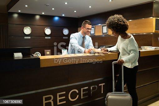 istock Tourist register in hotel 1067309392