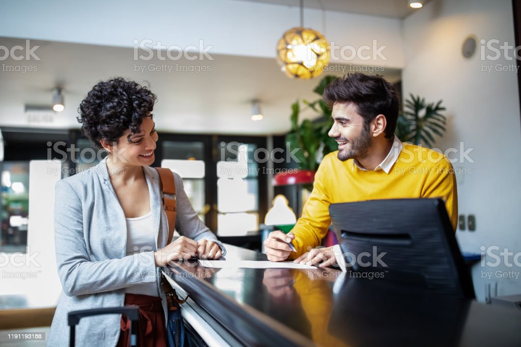 Tourist registering in hotel - Royalty-free Adult Stock Photo