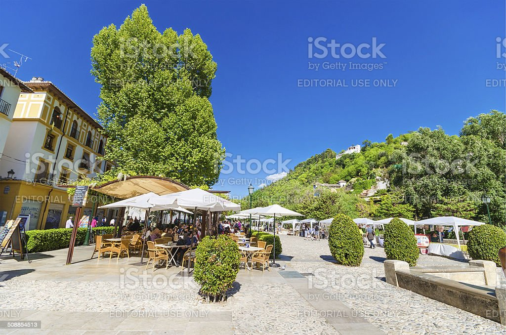 Tourist relaxing in a terrace, near Alhambra monument, Granada, Spain. stock photo