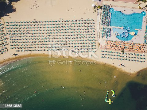 Drone point of view of beach with sunshades