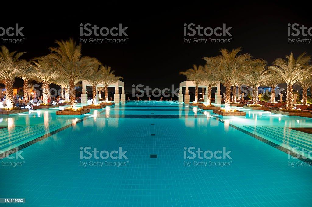 Tourist resort pool at night in Dubai UAE