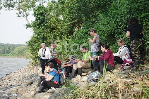 Tourist resting at the edge of Napo river in Yasuni National Park, near small town of Misahualli, Ecuador.
