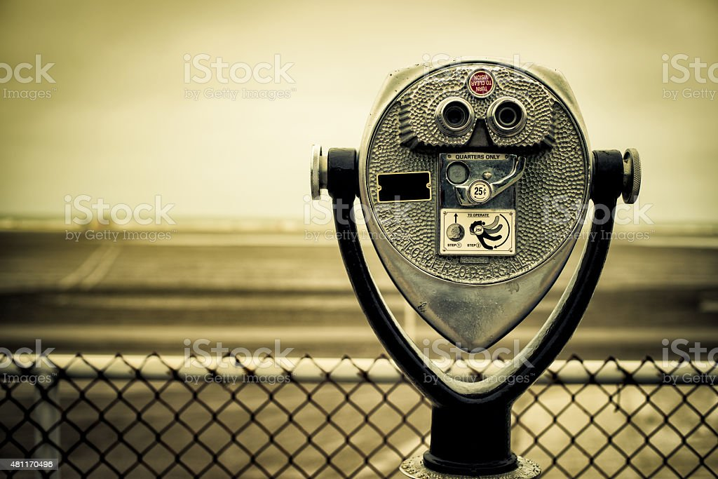 tourist retro coin operated binoculars on the beach stock photo