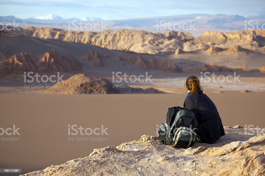 Tourist sat on rock looking Valle de la Luna, Chile stock photo