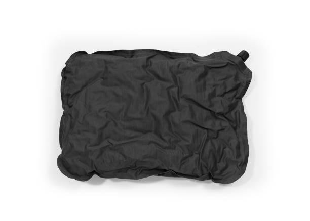 Tourist self-inflating pillow stock photo