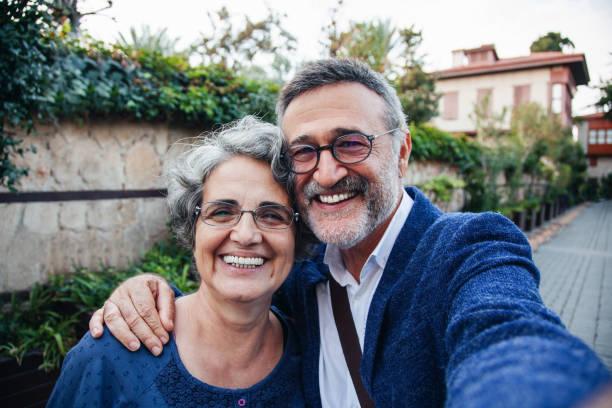 Tourist senior couple taking a selfie stock photo