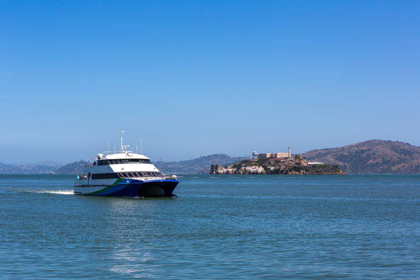 Tourist ship and Alcatraz Island in San Francisco, USA.