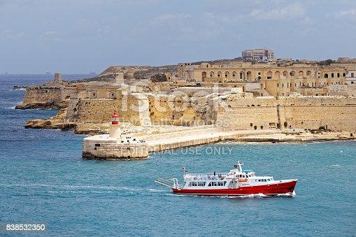 istock Tourist ship sails in front of St. Elmo, Malta 838532350