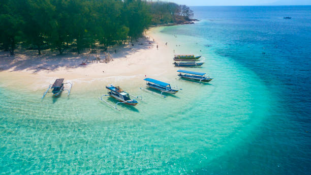 Tourist ships anchored on the Gili Rengit beach stock photo
