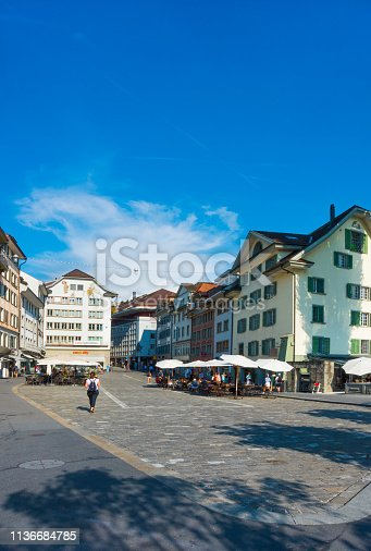 Tourist shops, cafes with restaurants is located in the square near Reuss River in Lucerne, Switzerland