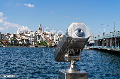istock TURKEY, ISTANBUL - may, 2020. Tourist Sightseeing Binoculars and Panoramic view to Galata tower, galata bridge Istanbul 1226657841