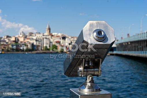 istock Tourist Sightseeing Binoculars and Panoramic view to Galata tower, galata bridge Istanbul 1226657886