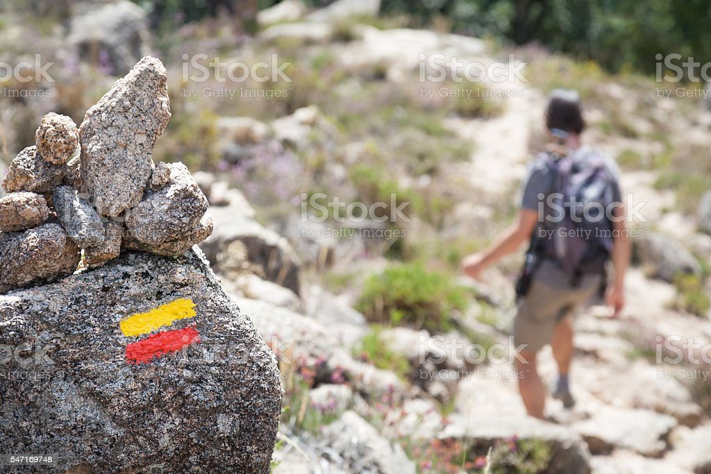 tourist signs on trail in mountains stock photo