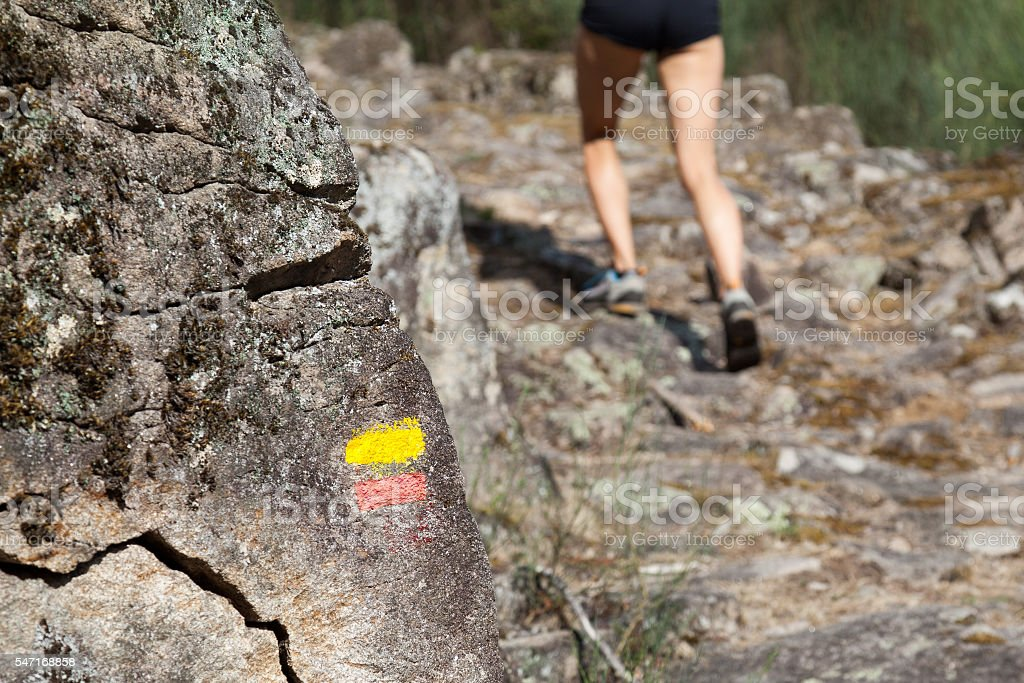 tourist signs trail mountains - running girl stock photo