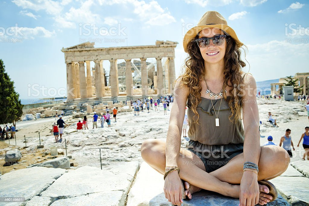Tourist sitting happily by a tourist destination stock photo