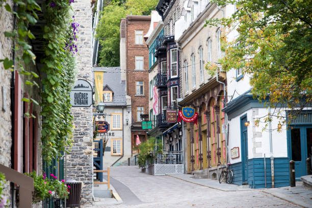 Tourist street in old cities Photo of the district of the little champlain, tourist place in the city of Quebec. old town stock pictures, royalty-free photos & images
