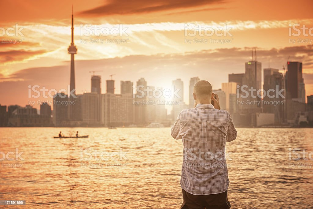 Tourist take a picture of Toronto skyline royalty-free stock photo