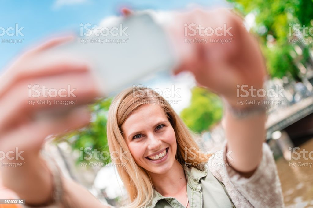 tourist take a selfie in amsterdam royalty-free stock photo