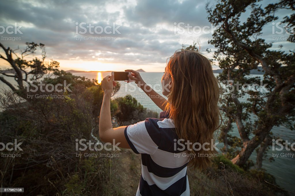 Tourist takes picture of beautiful landscape of Hauraki Gulf-New Zealand stock photo