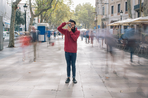 Tourist taking a photo in the city