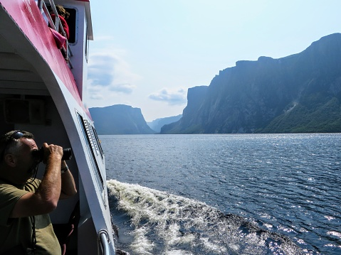 Western Brook Pond, Grose Morne National Park, Newfoundland, Canada - July 22nd 2014: A tourist taking a photo of the breathtaking views of the Western Brook Pond Tour in Newfoundland and Labrador.
