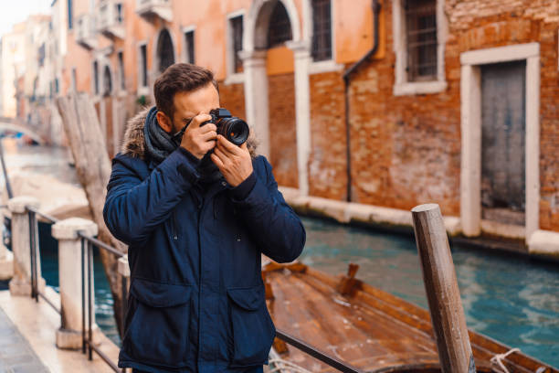Tourist taking photos in Venice stock photo