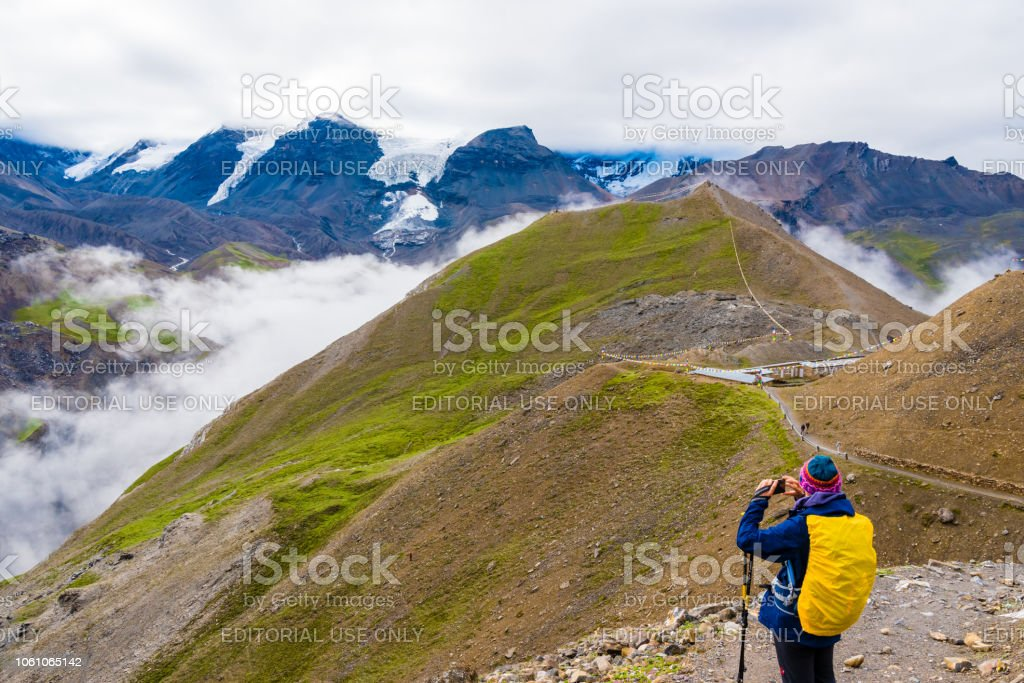 Tourist taking photos on the trek at Thorang-la pass basecamp, Annapurna Conservation Area, Nepal stock photo