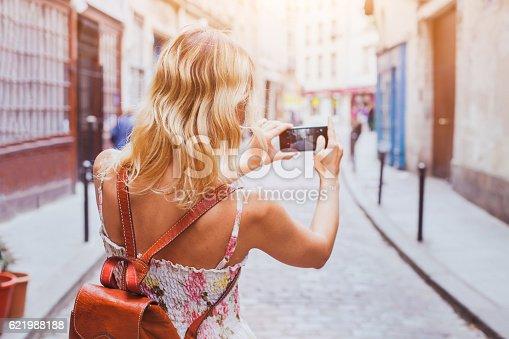 istock tourist taking photos 621988188