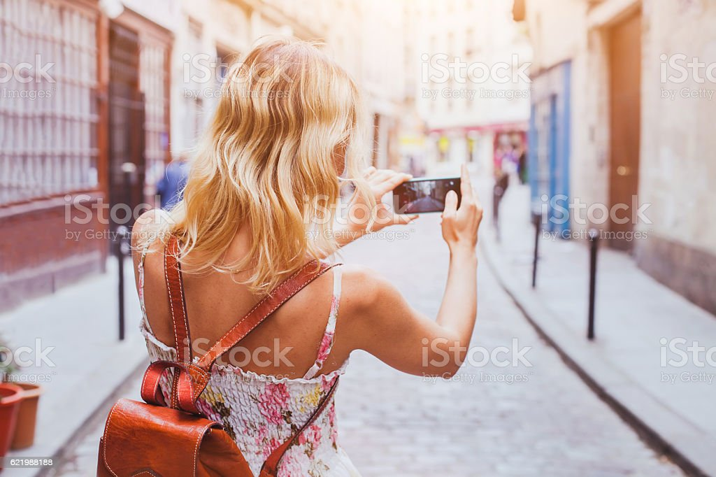 tourist taking photos stock photo