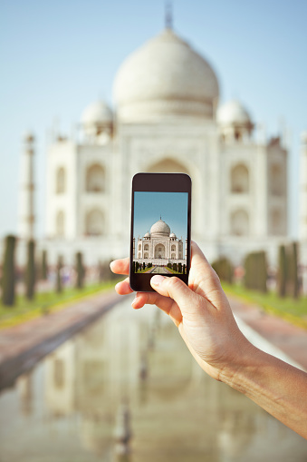 Tourist Taking Picture Of Taj Mahal Using Smart Phone Stock Photo - Download Image Now