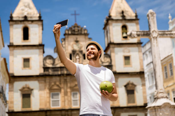 tourist taking selfie photo in salvador, bahia, brazil - south america travel stock photos and pictures