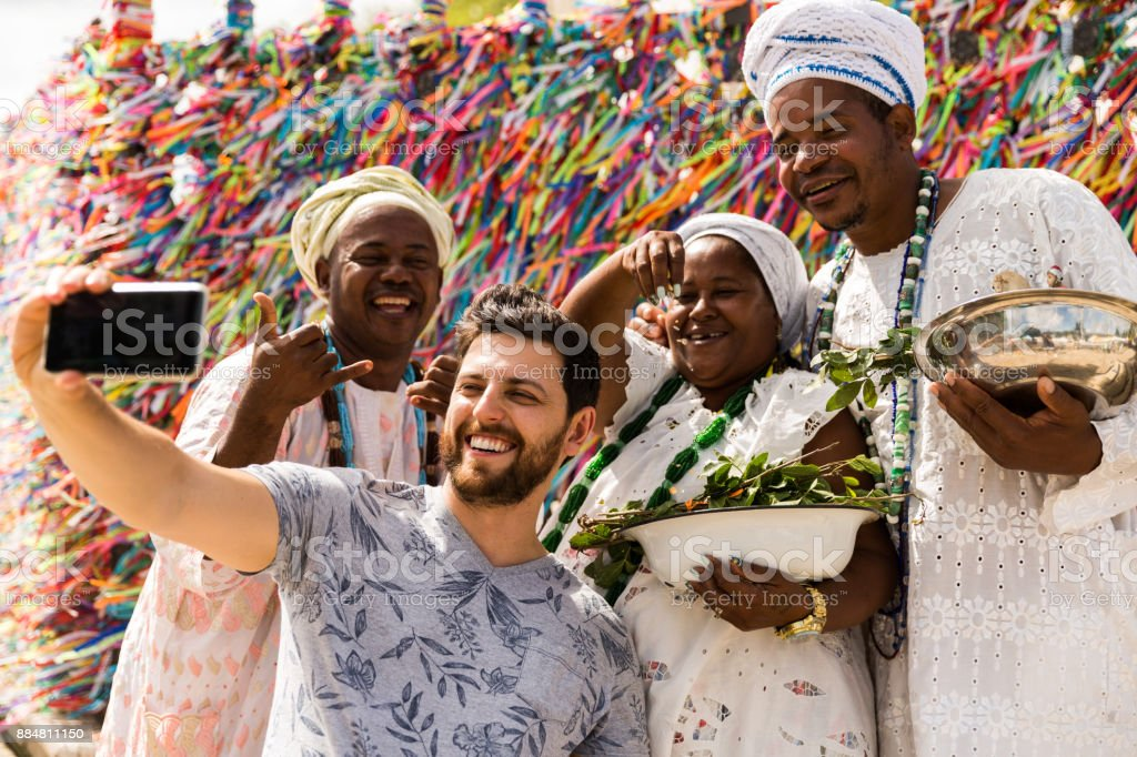 Tourist taking selfie photos with the locals in Salvador, Bahia, Brazil stock photo