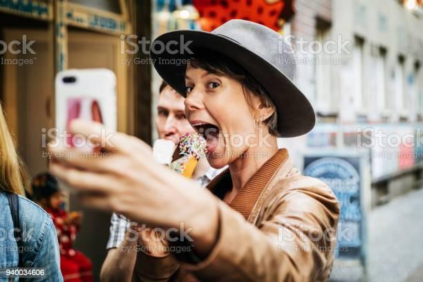 Tourist taking selfie while easting an ice cream picture id940034606?b=1&k=6&m=940034606&s=612x612&h=uduywjomtyesyusnyfgdrgyyf ybkt5qkd3les tslc=