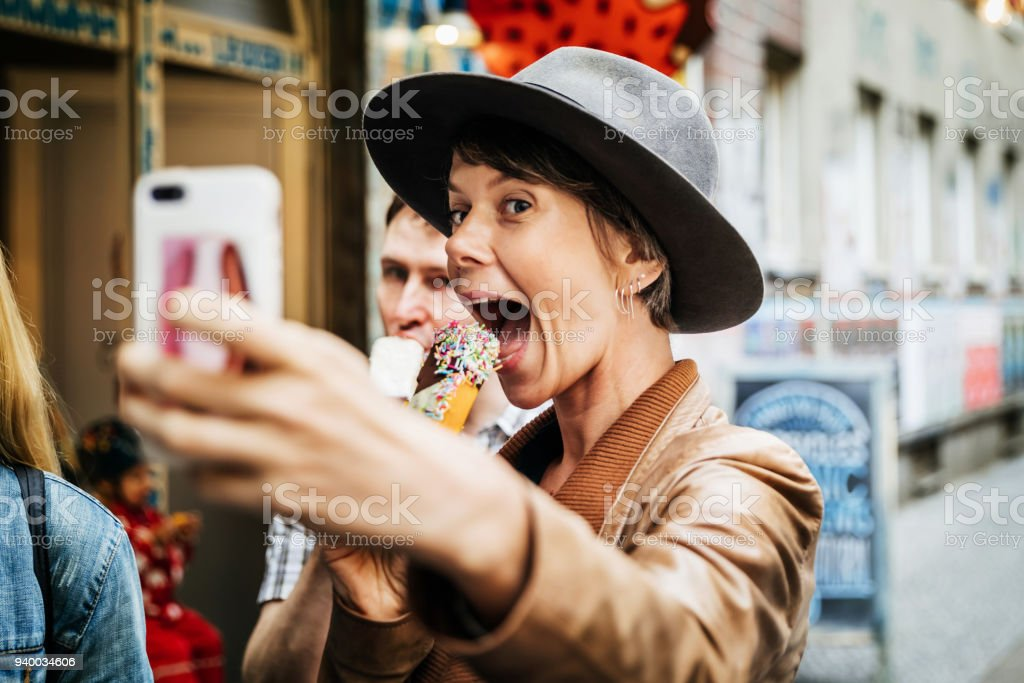 Tourist Taking Selfie While Easting An Ice Cream stock photo